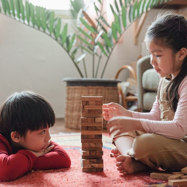 Kids playing with wooden games
