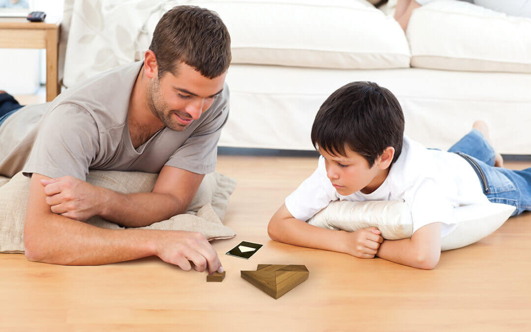 Parents giving wooden puzzles to kids